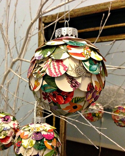 here is a very simple idea from allison patrick to make beautiful ornaments using 1 inch circles punched from the pages of a flower book - Home Decorative Things